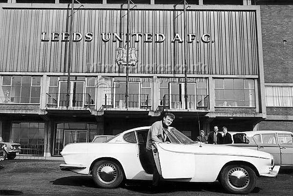 Leeds United captain Billy Bremner getting into his Volvo P1800