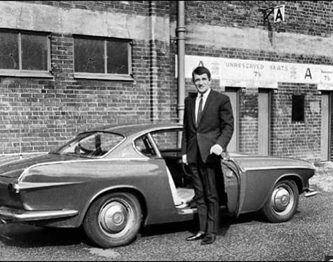 Manchester Uniteds striker David Herd outside Old Trafford in 1964 with his Volvo P1800