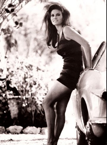 Raquel Welch, American actress and singer leaning against a Volvo P1800